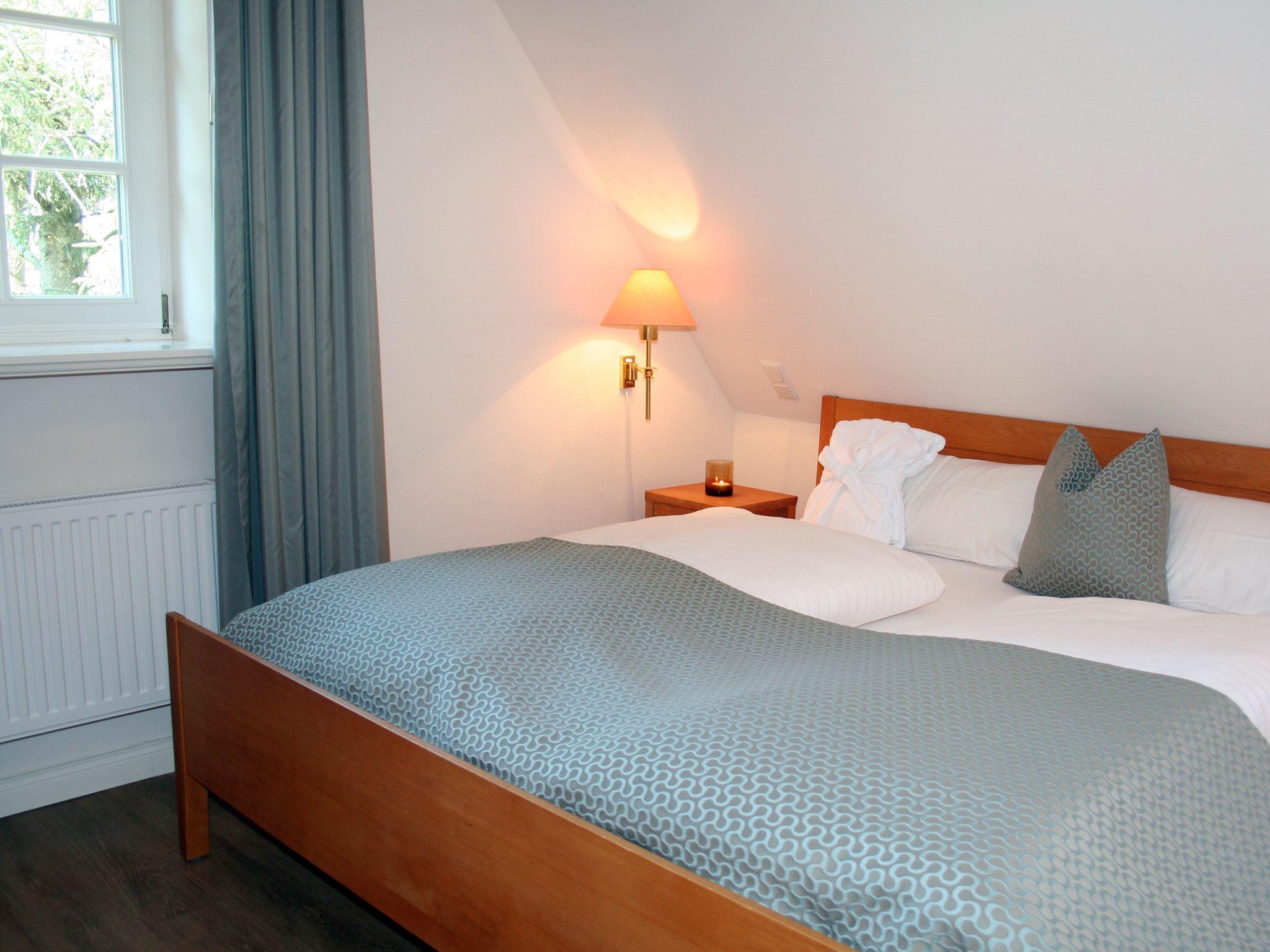 exklusive, strandnahe Ferienwohnung mit 5 DTV Sternen und Sauna/Fittnessraum,Kinderspielplatz Nr. 6a _ Schlafzimmer 2